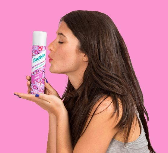 Woman with Batiste Sweetie dry shampoo.