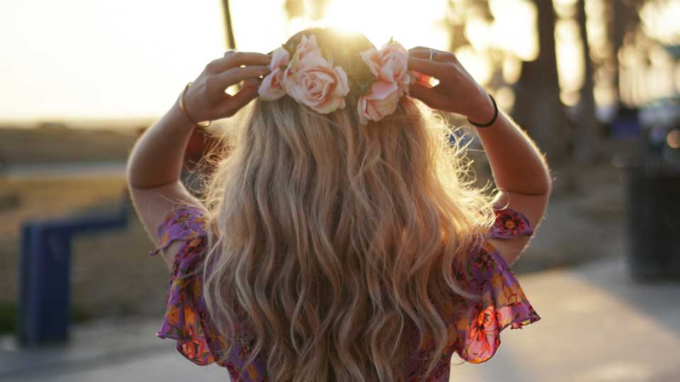 Blonde woman with flower crown.