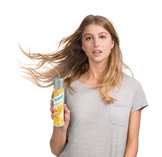 Woman showing how to use dry shampoo.